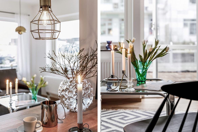 bord med ljusstake och vas
